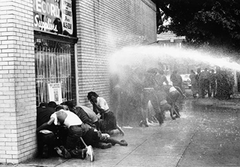 Protesters and firehose streams